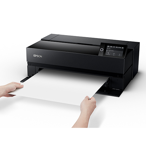 Epson-SureColor-P900-With-Hands-Holding-Blank-Paper